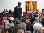 A member of the audience questioning, Kingston Mayor, Steve Noble and Police Chief Egidio F. Tinti, at a Community Policing Forum, sponsored by the Kingston Branch of ENJAN and the Ministers Alliance of Ulster Co., held at New Progressive Baptist Church, on Hone Street in Kingston, NY, on Tuesday, December 13, 2016. Photo by Jim Peppler; Copyright Jim Peppler 2016.