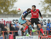 Lee Molyneux (R) of Morecambe challenge in the air with Pat Moran of Wycombe Wanderers during the Sky Bet League 2 match between Morecambe and Wycombe Wanderers at the Globe Arena, Morecambe, England on 29 April 2017. Photo by Stephen Gaunt / PRiME Media Images.