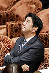 February 12, 2013, Tokyo, Japan - Japan's Prime Minister Shinzo Abe ponders questions asked by opposition lawmakers during a question-and-answer session of the Diet lower house Budget Committee in Tokyo on Tuesday, February 12, 2013. (Photo by AFLO)