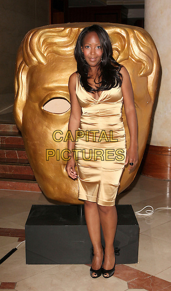 ANGELLICA BELL .2009 British Academy Television Craft Awards  at the London Hilton Hotel, London, England, UK, .May 17th 2009..Bafta Baftas TV Bafta's Anjellica Angelica Anjelica ful length gold dress black peep toe shoes ruched silk satin .CAP/ROS.©Steve Ross/Capital Pictures