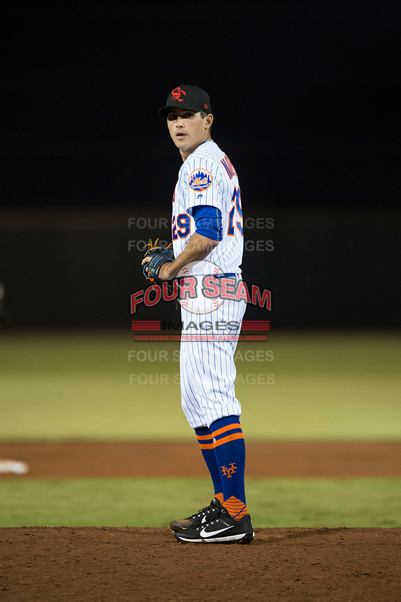 Scottsdale Scorpions relief pitcher Stephen Nogosek (29), of the New York Mets organization, gets ready to deliver a pitch during an Arizona Fall League game against the Mesa Solar Sox on October 9, 2018 at Scottsdale Stadium in Scottsdale, Arizona. The Solar Sox defeated the Scorpions 4-3. (Zachary Lucy/Four Seam Images)