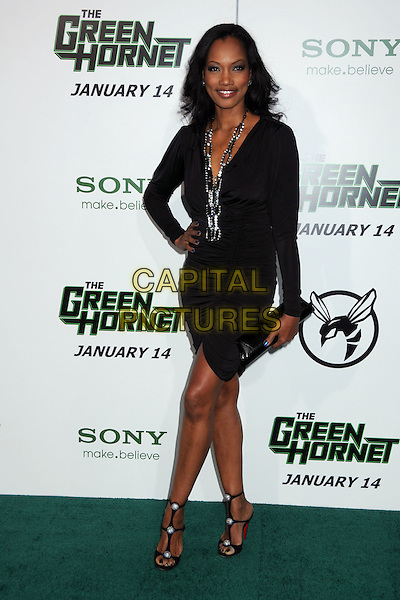 "GARCELLE BEAUVAIS-NILON .Attending Columbia Pictures' premiere of ""The Green Hornet"" Los Angeles Premiere held at Grauman's Chinese Theatre, Hollywood, California, USA, 10th January 2011..full length dress black long sleeve hand on hip christian louboutin shoes sandals silver necklace clutch bag baubles clutch bag ruched .CAP/ADM/BP.©Byron Purvis/AdMedia/Capital Pictures."