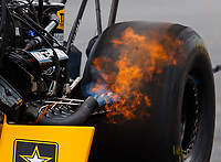 Jul 23, 2017; Morrison, CO, USA; Detailed view of fire from the header pipes on the dragster of NHRA top fuel driver Tony Schumacher during the Mile High Nationals at Bandimere Speedway. Mandatory Credit: Mark J. Rebilas-USA TODAY Sports