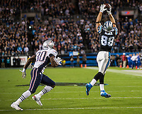 The Carolina Panthers play the New England Patriots at Bank of America Stadium in Charlotte North Carolina on Monday Night Football.  The Panthers defeated the Patriots 24-20.  Carolina Panthers tight end Greg Olsen (88) catches a pass in front of New England Patriots defensive back Duron Harmon (30)