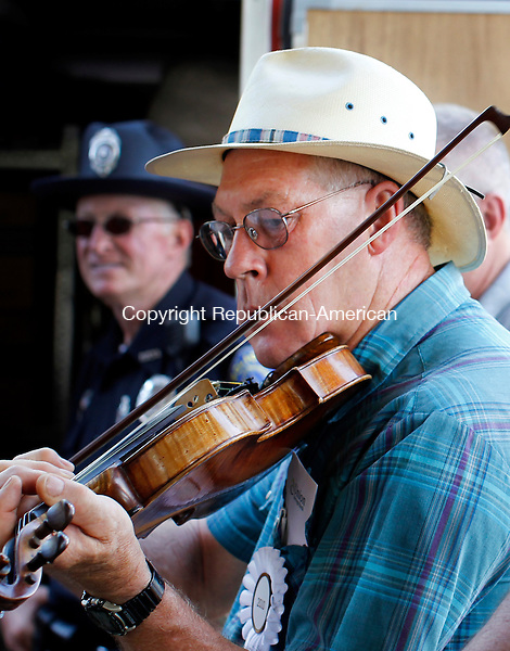 Roxbury, CT-11, July 2010-071110CM07  Legandary banjo player, Roger Sprung (Newtown), practices at the Pickin n' Fiddlin' Contest, hosted by the Roxbury Volunteer Fire Department Sunday afternoon in Roxbury.  The festival, held at Hurlburt Park featured musicians playing, banjos, fiddles and mandolins.  --Christopher Massa Republican-American