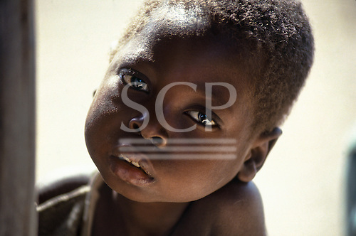 Kabinga, Zambia. Young sad-looking boy.