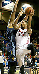 SIOUX FALLS, SD - NOVEMBER 22: Khem Birch #24 from the Sioux Falls Skyforce takes the ball to the basket against Hassan Whiteside #33 from the Iowa Energy in the first quarter of their game Saturday night at the Sanford Pentagon. (Photo by Dave Eggen/Inertia)