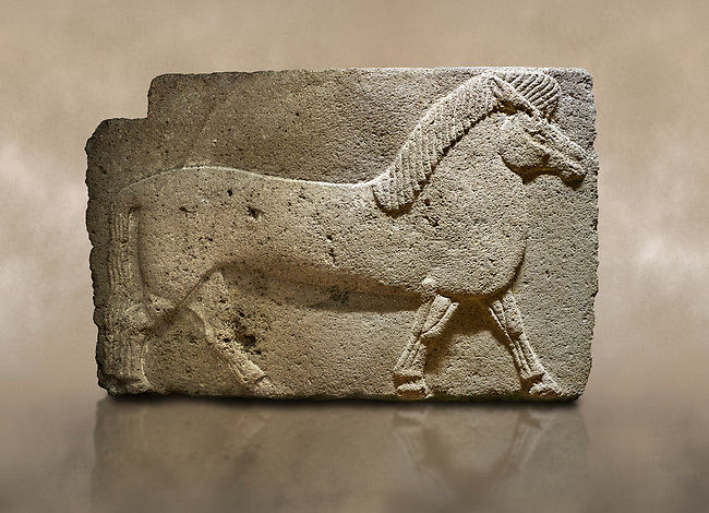 Photo of Phrygian relief sculpted orthostat stone panel. Andesite, Kucukevler, Ankara., 1200-700 B.C.  Walking horse. Muscles in the legs of the figure are schematic. Anatolian Civilisations Museum, Ankara, Turkey.<br /> <br /> Against a brown art background.