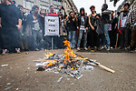 """© Joel Goodman - 07973 332324 . 26/03/2011 . London , UK . Protesters build a fire in a road junction at Oxford Circus . Hundreds of thousands of people attend an anti cuts demonstration under the banner """" March for the Alternative """" in central London , in protest at the coalition government's austerity measures . Photo credit : Joel Goodman"""