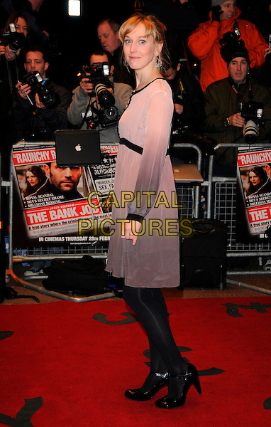 "HATTIE MORAHAN.World Premiere of ""The Bank Job"" held at the Odeon West End cinema, Leicester Square, London, England, February 18th 2008..full length grey brown beige tie tye dye dress black tights shoes side back over shoulder.CAP/CAN.?Can Nguyen/Capital Pictures"