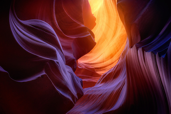A kaleidoscope of warm and cool colors created by reflected light in a remote Arizona slot canyon.