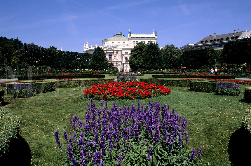 Beautiful flowers and Hofburg Imperial Palace in the in old town of Vienna Austria