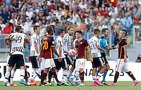 Calcio, Serie A: Roma vs Juventus. Roma, stadio Olimpico, 30 agosto 2015.<br /> Roma&rsquo;s Radja Nainggolan, right, argues with referee Nicola Rizzoli, second from right, and Juventus&rsquo; Paul Pogba, left, during the Italian Serie A football match between Roma and Juventus at Rome's Olympic stadium, 30 August 2015.<br /> UPDATE IMAGES PRESS/Riccardo De Luca