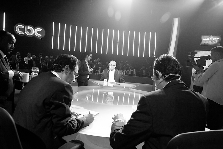 Egypt/ Cairo / 20.5.2012 / Ahmed Shafik at the Cbc studios for a national TV program. The candidate is interviewed by two journalists: Magdy Al-Gallad (in right foreground), editor of the Egyptian newspaper Al-Masry Al-Youm, and Khairy Ramadan (in left foreground), journalist and TV host. This is the last interview before the electoral silence, May 20th, 2012. Cairo, Egypt.<br /> <br /> © Giulia Marchi
