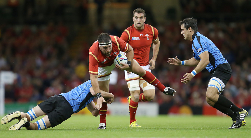Wales' Scott Baldwin is tackled by Uruguay's Matias Beer<br /> <br /> Photographer Ian Cook/CameraSport<br /> <br /> Rugby Union - 2015 Rugby World Cup - Wales v Uruguay - Sunday 20th September 2015 - Millennium Stadium - Cardiff<br /> <br /> &copy; CameraSport - 43 Linden Ave. Countesthorpe. Leicester. England. LE8 5PG - Tel: +44 (0) 116 277 4147 - admin@camerasport.com - www.camerasport.com