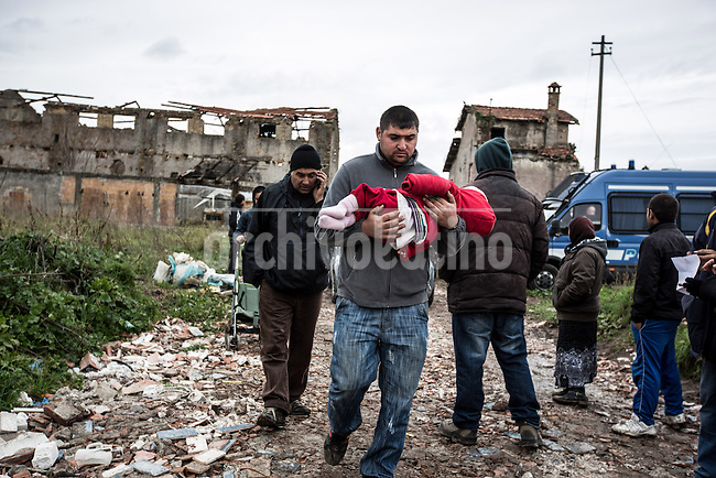 Rome, Italy, 29/1/2014. 100 eople including 40 kids are been evicted by police forces from an old house that was occupied several months ago. No other place to go was offered to them.