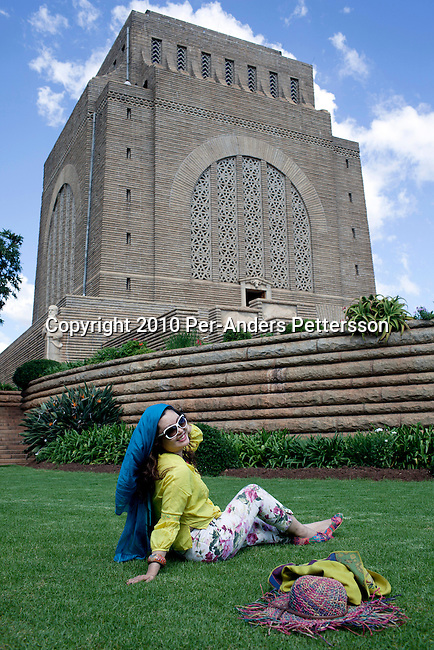 PRETORIA, SOUTH AFRICA - APRIL 29: A Chinese tourist poses at the Voortrekker Monument on April 29, 2010, in the Pretoria, South Africa. The Voortrekkers played an important part in Pretoria's past and South Africa's history. The capital of the Boer republic in Transvaal was named after Andries Pretorius, the victorious leader of the Boers in the war against the Zulus. The founders of the former South African Republic were honored by a colossal monument situated on Monument Hill, which is supposed to be a reminder of the courage, determination and persistence of the Voortrekkers. (Photo by Per-Anders Pettersson)