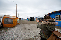 """Amid: <<I have been in Italy, Germany, Switzerland, France, Sweden, Denmark but I have never seen something like this>>.<br /> <br /> Calais Jungle Camp.<br /> <br /> Under the Sky of Calais & Dunkirk. Two Camps, Two Sides of the Same Coin: Not 'migrants', Not 'refugees', just Humans.<br /> <br /> France, 24-30/03/2016. Documenting (and following) Zekra and her experience in the two French camps at the gate of the United Kingdom: Calais' """"Jungle"""" and Dunkirk's """"Grande-Synthe"""". Zekra lives in London but she is originally from Basra in Iraq. Zekra and her family had to flee Kuwait - where they moved for working reason - due to the """"Gulf War"""", and to the Western Countries' will to """"export Democracy in Iraq"""". Zekra is a self-motivated volunteer and founder of """"Happy Ravers"""", a group of people (not a NGO or a charity) linked to each other because of their love for rave parties but also men and women who meet up every week to help homeless people and other people in need in Central London. (Here there are some of the stories I covered about Zekra and """"Happy Ravers"""": http://bit.ly/1XVj1Cg & http://bit.ly/24kcGQz & http://bit.ly/1TY0dPO). Zekra worked as an English teacher in the adult school at Dunkirk's """"Grande-Synthe"""" camp and as a cultural mediator and Arabic translator for two medic teams in Calais' """"Jungle"""". Please read her story at the beginning of this reportage."""
