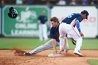 Cedar Rapids Kernels outfielder Max Murphy (13) loses his helmet stealing second as shortstop Steven Fuentes (16) covers the bag during a game against the West Michigan Whitecaps on June 7, 2015 at Fifth Third Ballpark in Comstock Park, Michigan.  West Michigan defeated Cedar Rapids 6-2.  (Mike Janes/Four Seam Images)