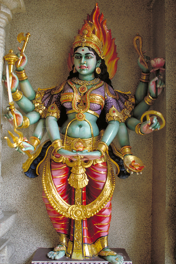 Hindu Temple decoration seen in Little India, Singapore depicting a multi-armed goddess. Singapore is a country in Malaysia. The population is mainly Chinese although Malays and Indians constitute large minorities. Buddhism, Islam, Hinduism, and Chri stia
