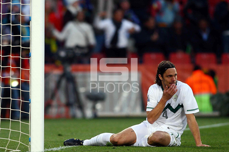 Marko Suler of Slovenia rues a missed chance on goal against USA