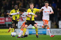 Blackpool's Nya Kirby vies for possession with Burton Albion's Jamie Allen<br /> <br /> Photographer Chris Vaughan/CameraSport<br /> <br /> The EFL Sky Bet League One - Burton Albion v Blackpool - Saturday 16th March 2019 - Pirelli Stadium - Burton upon Trent<br /> <br /> World Copyright &copy; 2019 CameraSport. All rights reserved. 43 Linden Ave. Countesthorpe. Leicester. England. LE8 5PG - Tel: +44 (0) 116 277 4147 - admin@camerasport.com - www.camerasport.com