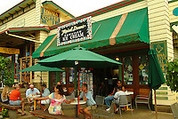 People relaxing at outside at an ice cream shop in the north Kohala town of Hawi, Big Island of Hawaii