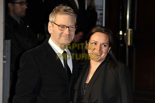 Kenneth Branagh & Lindsay Brunnock.'My Week With Marilyn' UK Premiere, Cineworld, Haymarket, London, England. .20th November 2011.half length black dress suit glasses married husband wife glasses  .CAP/MAR.© Martin Harris/Capital Pictures.