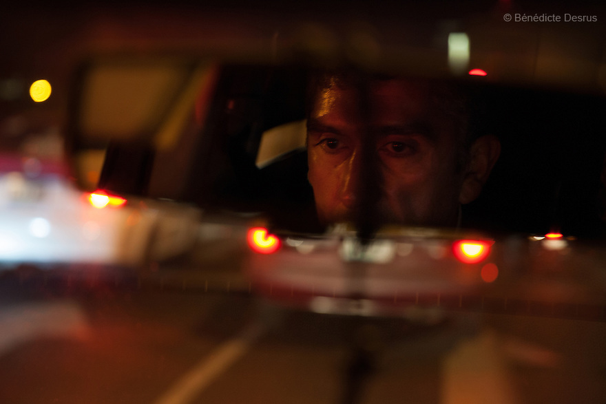 Donovan seen in the rear-view mirror of his car, late at night, after giving his business cards to the city&rsquo;s detective units in Mexico City on May 25, 2015. During his late-night drives, he likes to smoke, listen to AM radio songs, and watch the empty streets around him. It is a kind of ritual for him.<br /> Donovan Tavera, 43, is the director of &ldquo;Limpieza Forense M&eacute;xico&rdquo;, the country&rsquo;s first and so far the only government-accredited forensic cleaning company. Since 2000, Tavera, a self-taught forensic technician, and his family have offered services to clean up homicides, unattended death, suicides, the homes of compulsive hoarders and houses destroyed by fire or flooding. Despite rising violence that has left 70,000 people dead and 23,000 disappeared since 2006, Mexico has only one certified forensic cleaner. As a consequence, the biological hazards associated with crime scenes are going unchecked all around the country. Photo by B&eacute;n&eacute;dicte Desrus