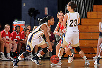 28 January 2012:  FIU guard Jerica Coley (22) drives to the basket with the help of a pick from guard-forward Finda Mansare (23) on WKU guard Ellen Sholtes (11) in the first half as the FIU Golden Panthers defeated the Western Kentucky University Hilltoppers, 60-56, at the U.S. Century Bank Arena in Miami, Florida.  Coley, who has scored the second-most points of any women's player in the country, finished the game with 36 points and surpassed the 1,000 point mark.