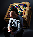 Ian Penna, sculptor, in front of his work - 'Flawed'.<br /> <br /> Portrait commissioned by FALMOUTH ART GALLERY.