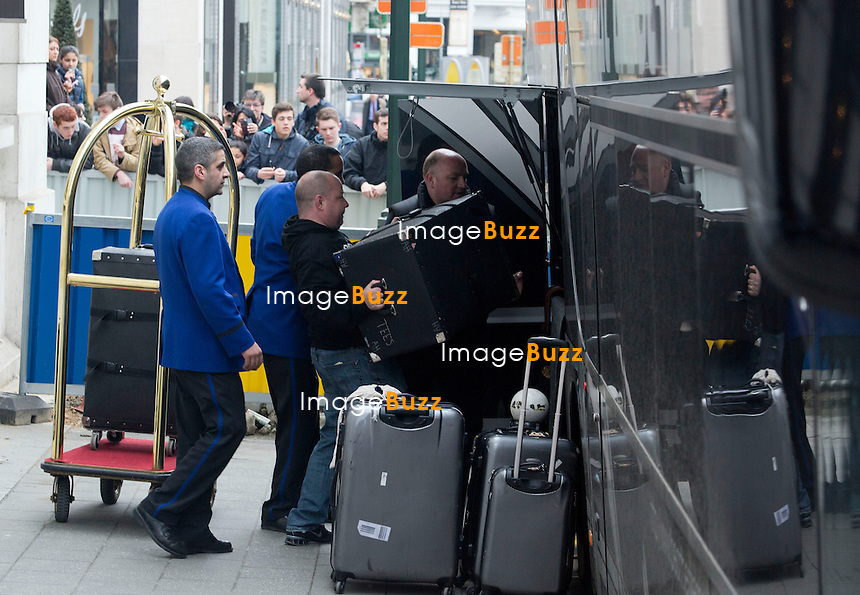 """Justin Bieber touring in Belgium - Justin Bieber arrived from France in Belgium-Brussels,  on April 9th at 4 am with his black/grey touring bus """"  Beat the streets """"..He checked into the  """" Steigenberger """"  hotel in Brussels. A few hours later, his fans were surrounding the front and back entrance of his hotel, that the security of the hotel could not handle such a craziness and had to get some big help from the brussels police. About 40 police officers arrived to surround the hotel to protect the star who had two concerts in the city of Antwerp. But Justin asked the police to leave, which they did after a while!! Justin kept hiding in the hotel between the fitness center kept opened only for him, as well the swimming pool where he did some water polo with his musicians. The bar of the hotel even got closed to the guests of the hotel around 6pm, to let justin enjoying the bar. On the first day of his concert, Justin escaped his fans by jumping from his Mercedes van into his tour bus, hided by his bodyguards. Justin's musicians even played the piano at the piano bar  of the hotel, singing Elton John's songs! It's only on his 3rd and last day in Brussels  ( April11th ) that Justin Bieber finally agreed to meet with his fans on the street. Brussels, April 10th & 11th, 2013..Pictured : Justin  Bieber during his concert in Antwerop on April 11th..Pictured : Justin Bieber's luggage"""