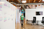Daniel Negari bought a former Yahoo office to house his business .XYZ. The office has a community kitchen (seen here), whiteboard walls, and lots of unique art throughout. Company COO Mike Ambrose walks through the office in Santa Monica, California July 29, 2015. <br /> (Photo by Kendrick Brinson)