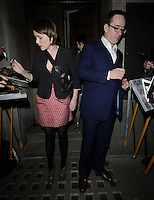 "KEELEY HAWES & MATTHEW MACFADYEN.At the ""Private Lives"" Press Night, Vaudeville Theatre, London, England, UK, March 3rd 2010..full length grey gray jacket red and white polka dot dress black tights booties ankle boots cross body strap bag blue suit glasses married couple husband wife signing autographs for fans .CAP/CAN.©Can Nguyen/Capital Pictures."
