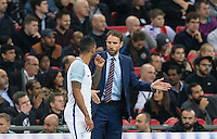 England Caretaker Manager (Head Coach) Gareth Southgate gives instructions to Theo Walcott (Arsenal) of England during the International Friendly match between England and Spain at Wembley Stadium, London, England on 15 November 2016. Photo by Andy Rowland.