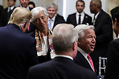 United States President Donald J. Trump, left, talks to International Monetary Fund Managing Director Christine Lagarde, second left, next to the owner of the New England Patriots Robert Kraft, second from the right, and Qatar's Emir Sheikh Tamim bin Hamad Al Thani, right, during a dinner hosted by US Secretary of the Treasury Steven T. Mnuchin at the Department of Treasury on July 8, 2019 in Washington, DC. <br /> Credit: Oliver Contreras / Pool via CNP