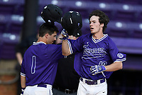 Center fielder Ben Anderson (17) of the Furman Paladins is congratulated by Sims Griffith as he crosses the plate after hitting a home run in game two of a doubleheader against the Harvard Crimson on Friday, March 16, 2018, at Latham Baseball Stadium on the Furman University campus in Greenville, South Carolina. Furman won, 7-6. (Tom Priddy/Four Seam Images)