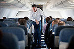 GOP presidential candidate Mitt Romney speaks to staff members while flying from Sparks to Elko, Nevada, February 3, 20112.