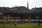 Prescot Cables 2 Brighouse Town 1, 13/02/2016. Hope Street, Northern Premier League. First-half action as Prescot Cables (in orange) take on Brighouse Town in a Northern Premier League division one north fixture at Valerie Park. Founded in 1884, the 'Cables' in their name came from the largest local employer, British Insulated Cables and they have played in their current ground, also known as Hope Street, since 1906. Prescott won the match 2-1 watched by a crowd of 189. Photo by Colin McPherson.