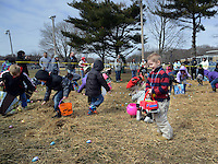 Sam Sherrill, 5 years old, (stripe shirt) races along with other children to find Easter Eggs in the hay during the Easter Egg Hunt Saturday March 28, 2015 at the Bristol Township Musical Complex football field in Bristol Township, Pennsylvania. About 250 children participated in the hunt to find about 3,000 Easter Eggs. (Photo by William Thomas Cain/Cain Images)