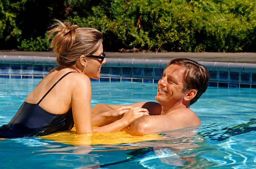 ROMANTIC COUPLE enjoy each others company in the SWIMMING POOL (MR)