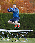 Barrie McKay jumping over the wee hurdles at training
