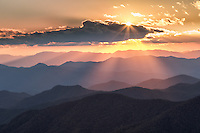 Sunbeams streaming down from clouds at sunset onto Blue Ridge Mountains from Blue Ridge Parkway, North Carolina