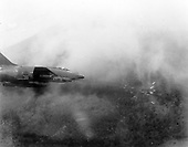 A United States Air Force F-100 Super Sabre fires a salvo of rockets at a jungle target, May 1967.  .Credit: U.S. Air Force via CNP
