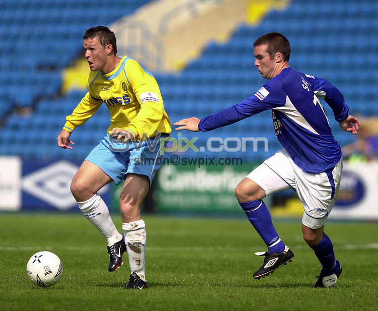 Pix:Chris Whiteoak/SWpix.com...Football -Conference, Carlisle United v Canvey Island....14/08/2004. ..COPYRIGHT PICTURE>>SIMON WILKINSON>>01943 608782>>..Canvey's Neil Gregory gets away from Carlisle's Brian Shelley.