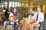 LIBRARIANS: Aishlinn O'Halloran and Tommy O'Connor (County Librarian) at Tralee library, one of nine in the county which saw record lendings in 2011.