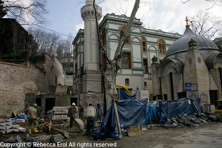 Workmen working on the restoration of the Seyh Zafir Mosque in Besiktas, Istanbul, Turkey