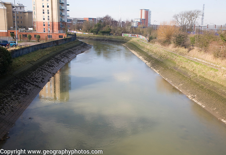 Concrete revetments reinforcing river banks to increase channel efficiency, River Gipping, Ipswich, Suffolk, England