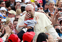 Papa Francesco bacia un bambino al suo arrivo all'udienza generale del mercoledi' in Piazza San Pietro, Citta' del Vaticano, 7 maggio 2014.<br /> Pope Francis kisses a child as he arrives for his weekly general audience in St. Peter's Square at the Vatican, 7 May 2014.<br /> UPDATE IMAGES PRESS/Isabella Bonotto<br /> <br /> STRICTLY ONLY FOR EDITORIAL USE