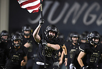 NWA Democrat-Gazette/CHARLIE KAIJO Bentonville players run out onto the field, Friday, November 1, 2019 during a football game at Bentonville High School in Bentonville.